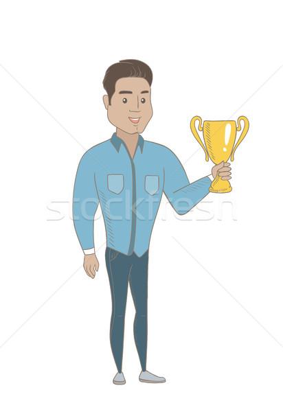 Młodych hiszpańskie biznesmen trofeum złoty Zdjęcia stock © RAStudio
