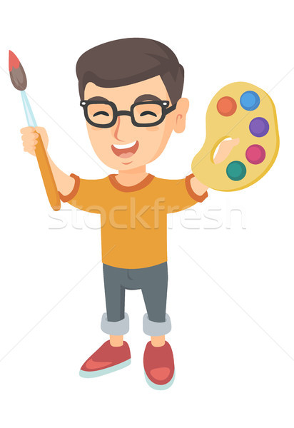 Happy boy drawing with colorful paints and brush. Stock photo © RAStudio
