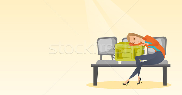 Tired woman sleeping on suitcase at the airport. Stock photo © RAStudio