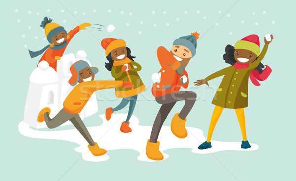 Multicultural family playing snowball fight. Stock photo © RAStudio
