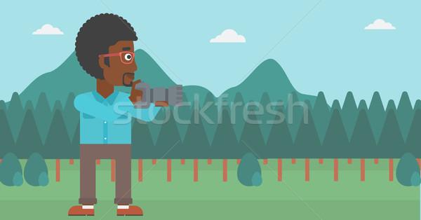 Fotós elvesz fotó férfi zöld erdő Stock fotó © RAStudio