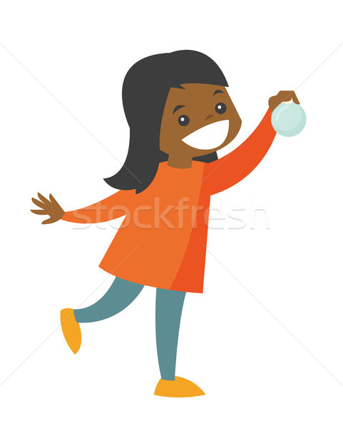 Young african-american girl holding christmas ball Stock photo © RAStudio