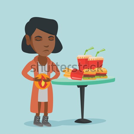 African woman holding tray full of fast food. Stock photo © RAStudio