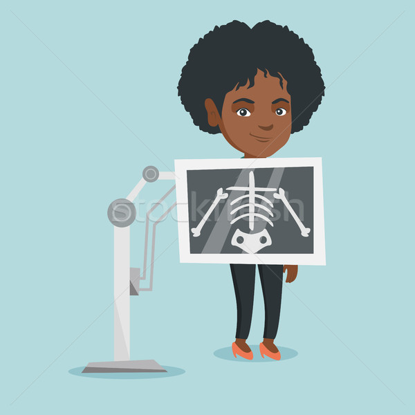 Young african woman during x ray procedure. Stock photo © RAStudio