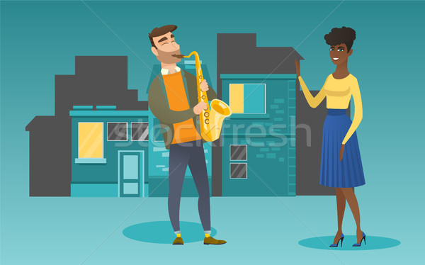 Musician playing the saxophone for his girlfriend. Stock photo © RAStudio