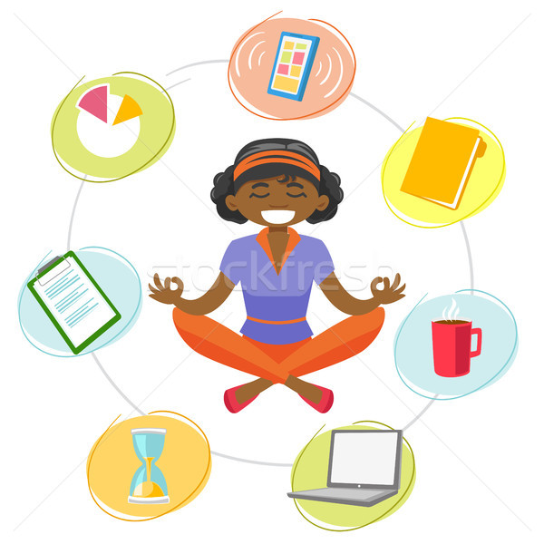 Business woman meditating in yoga lotus position. Stock photo © RAStudio