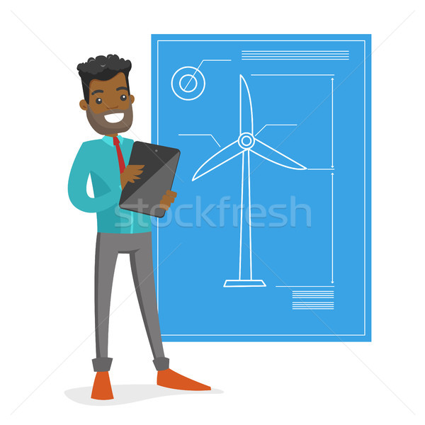 African engineer projecting a wind turbine. Stock photo © RAStudio