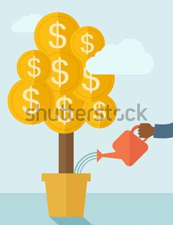 Human hand watering the money tree. Stock photo © RAStudio