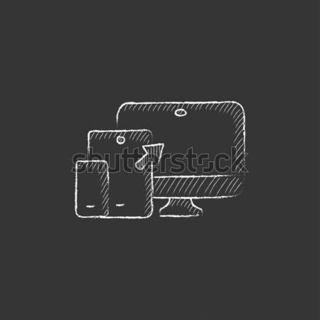 Synchronization computer with mobile device icon drawn in chalk. Stock photo © RAStudio