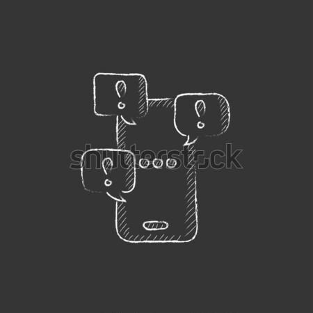 Man with speech square icon drawn in chalk. Stock photo © RAStudio