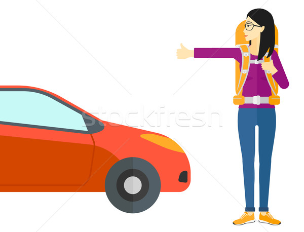 Young woman hitchhiking. Stock photo © RAStudio