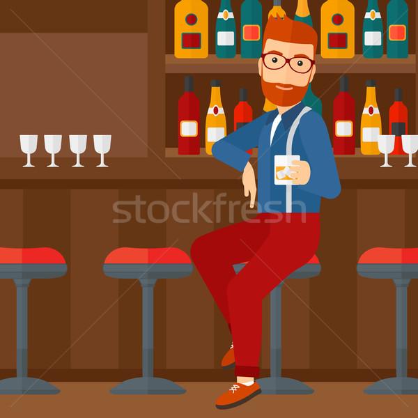 Man sitting at bar. Stock photo © RAStudio