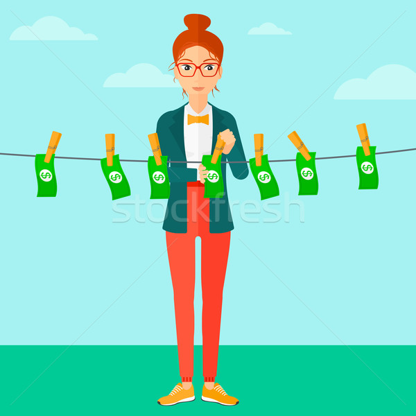 Woman loundering money. Stock photo © RAStudio