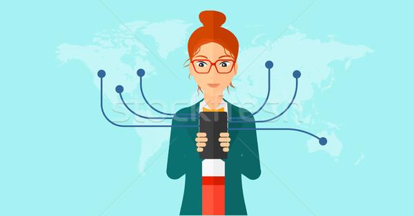 ストックフォト: 女性 · スマートフォン · 全体 · 世界 · 青