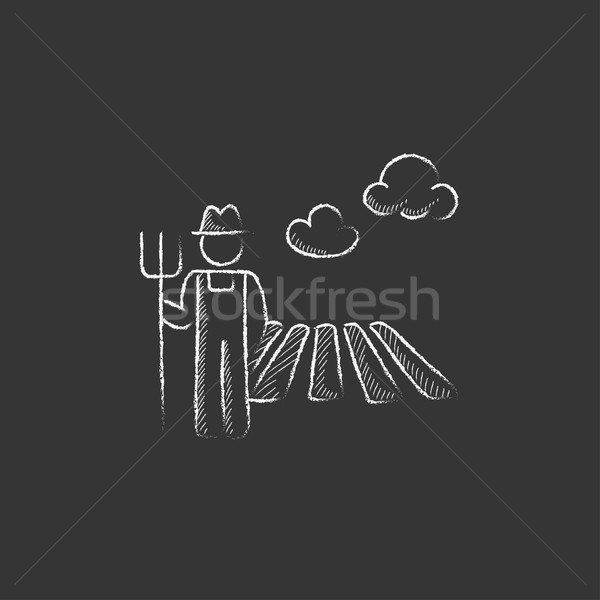 Farmer with pitchfork. Drawn in chalk icon. Stock photo © RAStudio