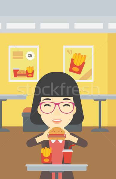 Kadın yeme hamburger Asya genç kadın mutlu Stok fotoğraf © RAStudio