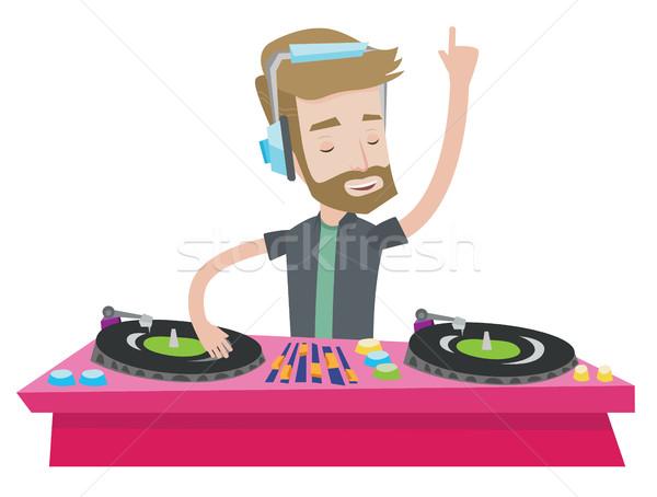 Zene lemezjátszók hipszter fiatal szakáll játszik Stock fotó © RAStudio