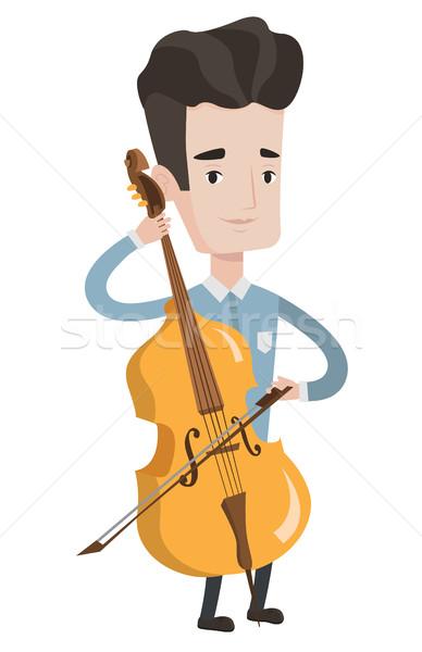 Férfi játszik cselló fiatal boldog kaukázusi Stock fotó © RAStudio