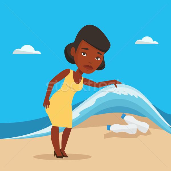 женщину пластиковых бутылок морем волна Сток-фото © RAStudio