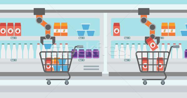 Robotic arm putting groceries in shopping trolley. Stock photo © RAStudio