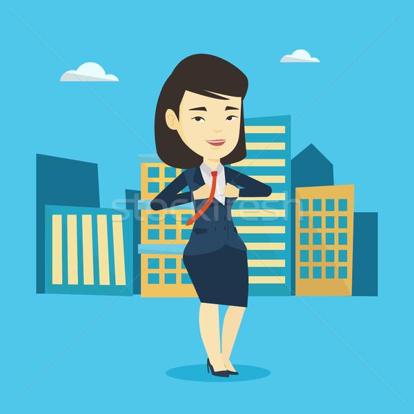 Business woman opening her jacket like superhero. Stock photo © RAStudio