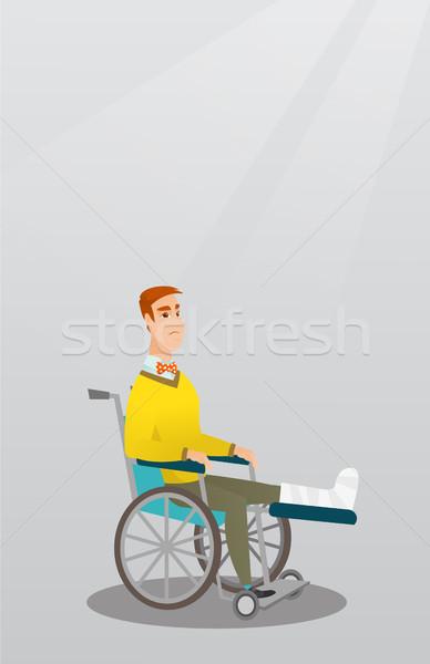 Homme jambe cassée séance fauteuil roulant jeunes triste Photo stock © RAStudio