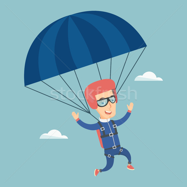 Young happy man flying with a parachute. Stock photo © RAStudio