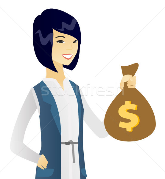 Young asian business woman holding a money bag. Stock photo © RAStudio