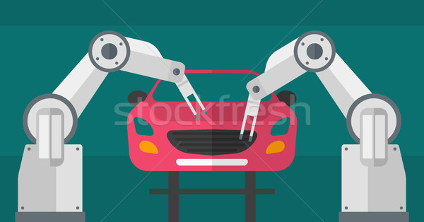Robotic arm assembling car in assembly shop. Stock photo © RAStudio