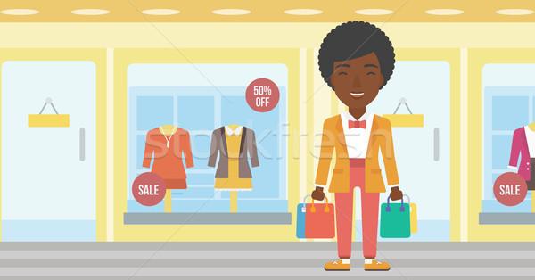 幸せ 女性 袋 ショッピングバッグ ブティック ストックフォト © RAStudio