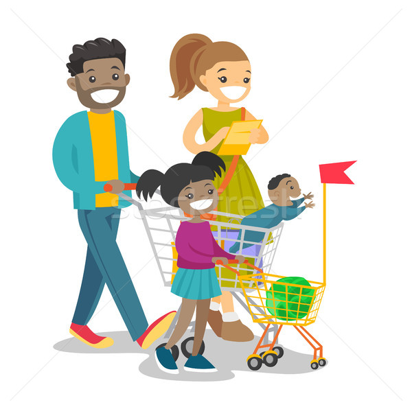 Young multicultural family with kids shopping. Stock photo © RAStudio