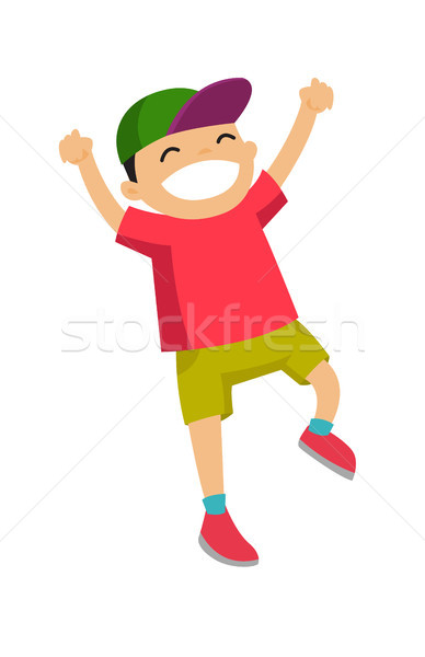 Stock photo: Caucasian white boy jumping with raised hands up.