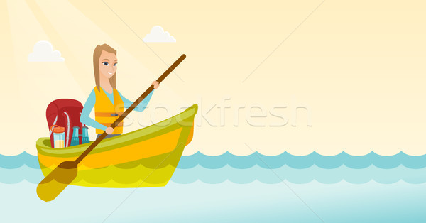 Young caucasian woman riding a kayak. Stock photo © RAStudio