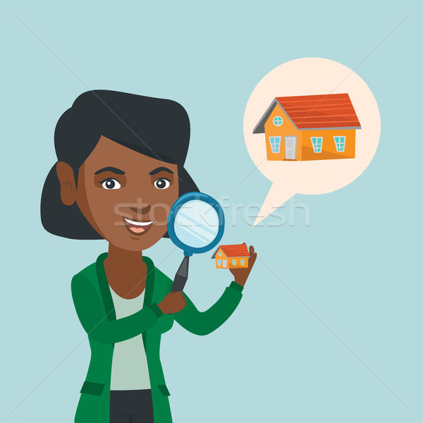 Young african-american woman looking for a house. Stock photo © RAStudio