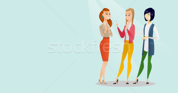 Three multiracial friends looking at mobile phone. Stock photo © RAStudio