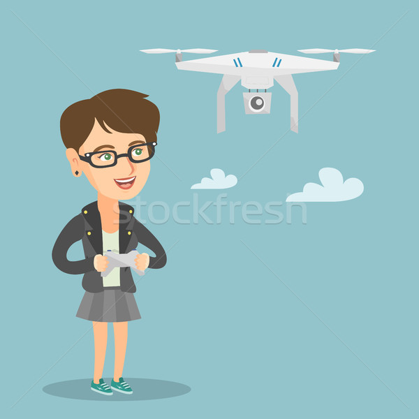 Young caucasian woman flying drone. Stock photo © RAStudio