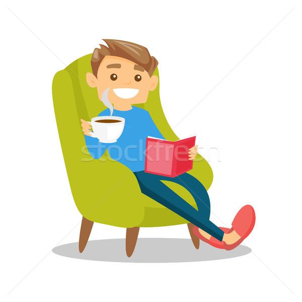 Young caucasian white man reading a book. Stock photo © RAStudio