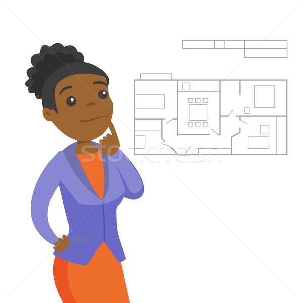 Woman thinking about blueprint of new apartment. Stock photo © RAStudio