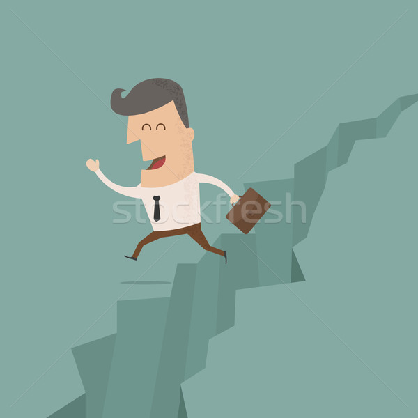 Stock photo: businessman jump through the gap