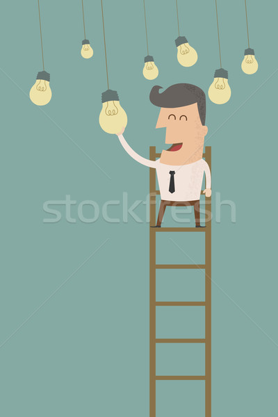 business man catching a light bulb , eps10 vector format Stock photo © ratch0013