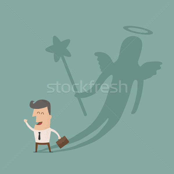 Businessman casting a angel shadow Stock photo © ratch0013