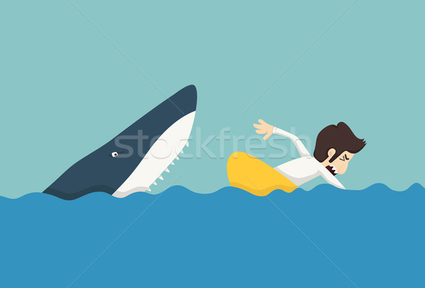 Stock photo: Businessman swimming to escape sharks