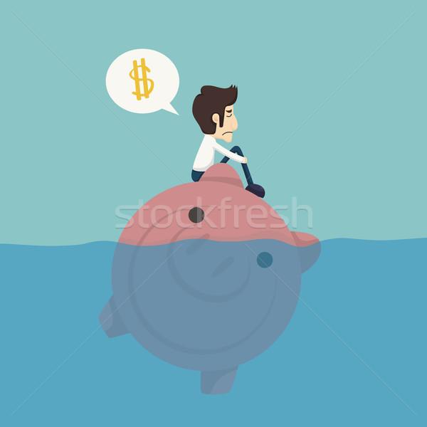 Businessman sitting on a piggybank , businessman no money Stock photo © ratch0013