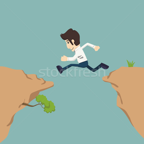 Businessman jumping over gap Stock photo © ratch0013