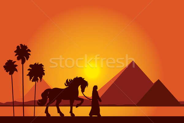 Egypt Great Pyramids with silhouette of Bedouin and horse on sun Stock photo © Ray_of_Light