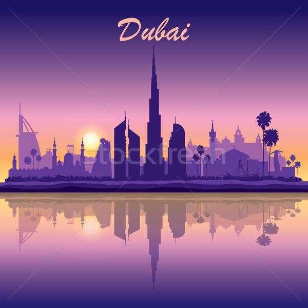 Dubai linha do horizonte silhueta pôr do sol edifício viajar Foto stock © Ray_of_Light