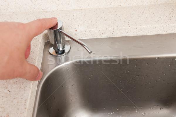 Hand pressing sanitizer Stock photo © raywoo