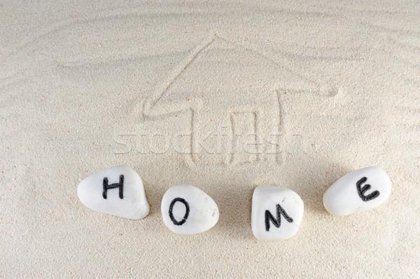 Casa palabra grupo piedras arena casa Foto stock © raywoo