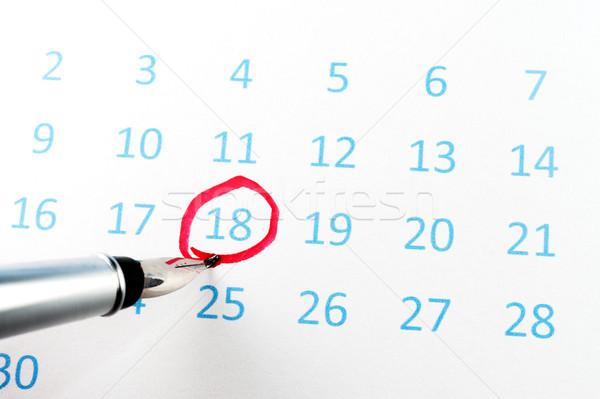 Red circle on calendar Stock photo © raywoo