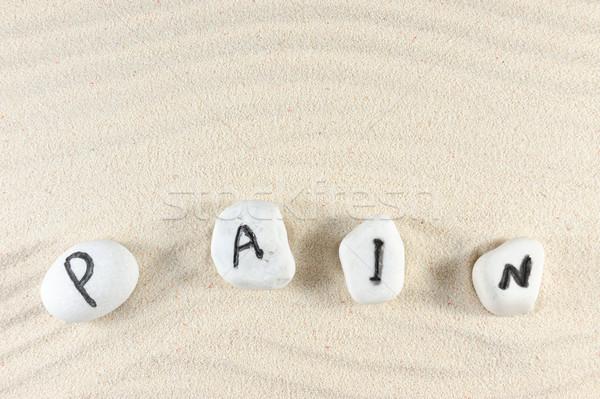 Fájdalom szó csoport kövek homok textúra Stock fotó © raywoo